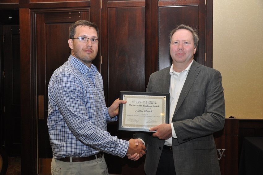 Jamie Creech winner of a Staff Excellence Award, non-exempt category, with Dean Larry Holloway
