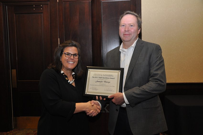 Jennier Doerge, winner of a Staff Excellence Award in the exempt category, with Dean Larry Holloway