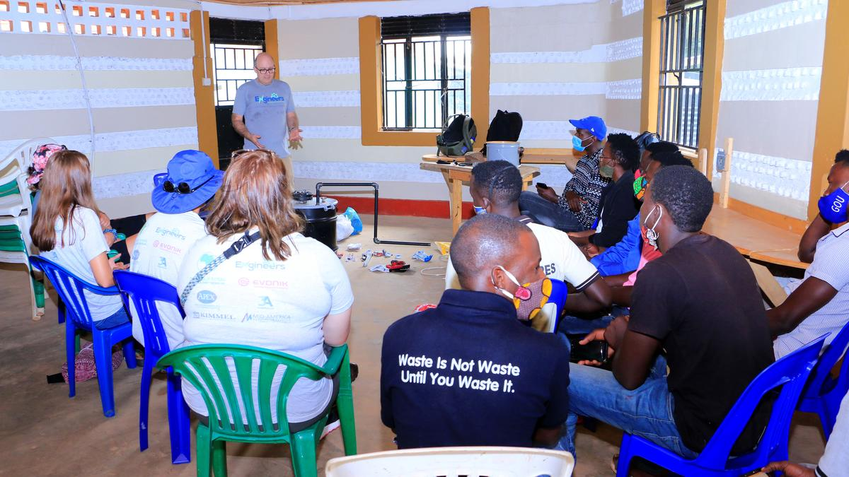 Professor Jeff Seay conducts a training session on the Trash-to-Tank Processor for the staff of Upcycle Africa in Mpigi, Uganda.